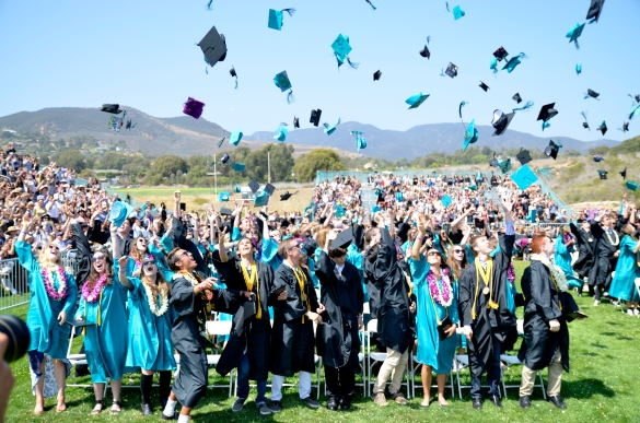 Malibu High School graduates throw their caps in the air during the graduation ceremony on Friday, June 6, 2014 at Malibu High School in Malibu, Calif.