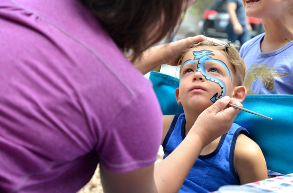 Shai Walters, 4, gets his face painted on Sunday, May 17, 2015 during the Spring Fair and Triathlon fundraiser hosted by Children's Creative Workshop at Point Dume Marine Elementary School in Malibu, Calif.